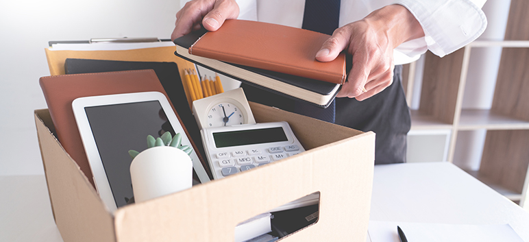 A businessman packing a box for the commercial movers in Manhattan NY Zenith Moving