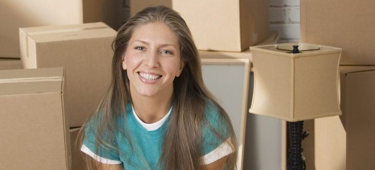A smiling woman using our residential moving services in Manhattan, NY.