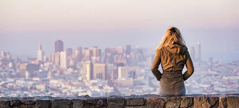 A girl looking at the NYC from afar.