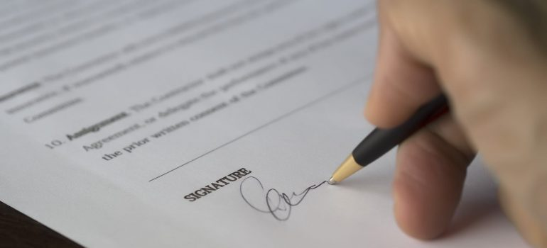 A person signing their signature