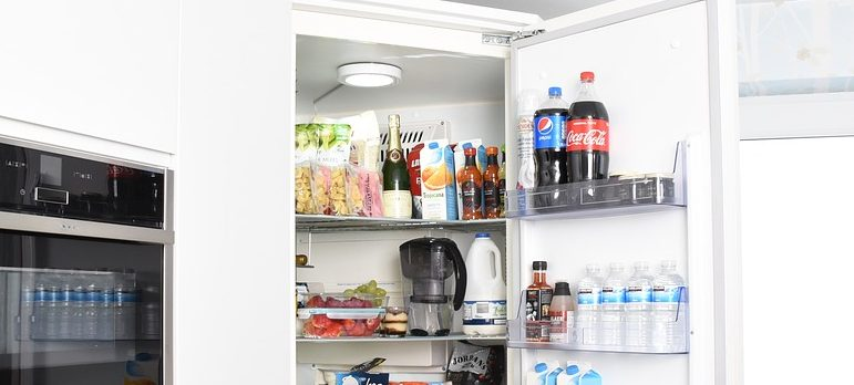 A fridge full of food you need to empty before packing a fridge for moving