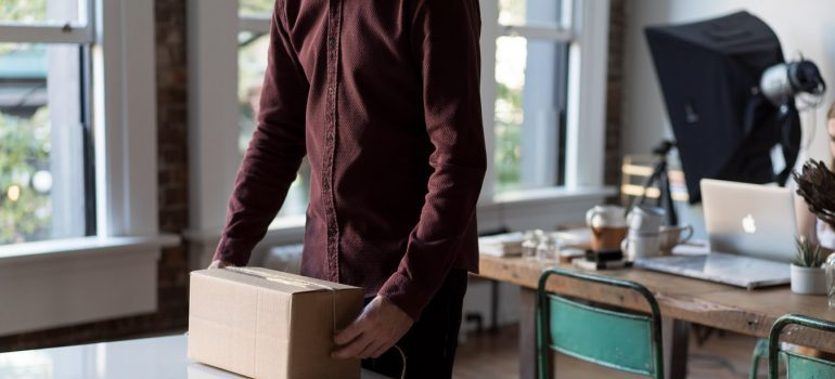 A man packing for his move