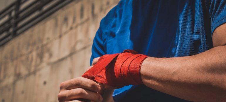 A man bandaging his hands