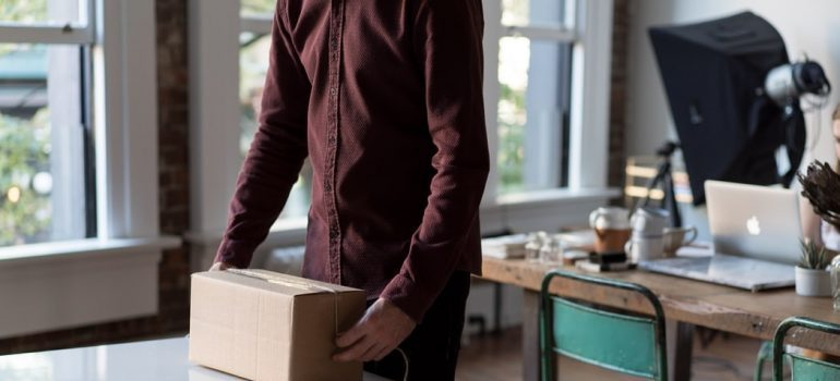 A man packing for a move