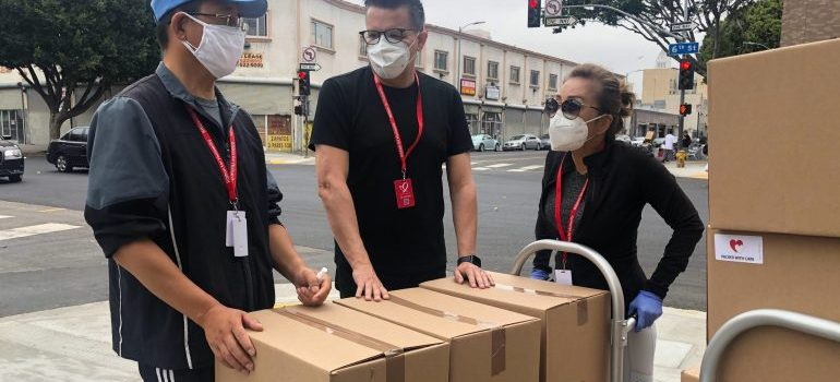 3 people with moving boxes
