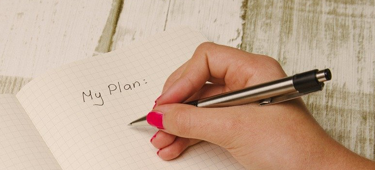 person writing down a plan