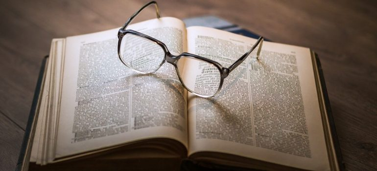 a pair of glasses on an open book