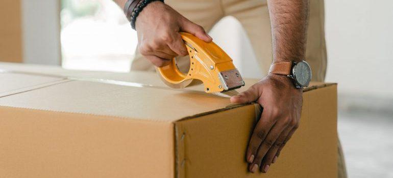 Professional packer sealing a box